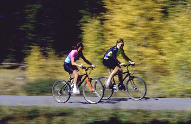 two people biking